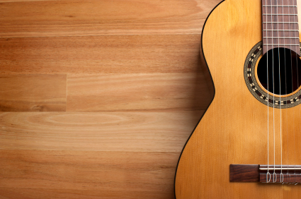 Acoustic guitar with wood background