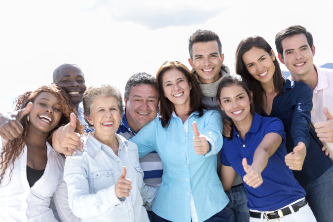 Happy group of people with thumbs up
