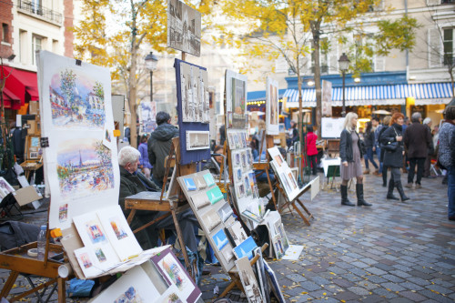 PARIS, FRANCE - November 23, 2014: Artists in Place du Tertre. Many artists set up their easels each day for the tourists in this famous and picturesque square in Montmartre